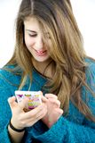 Girl playing with cell phone Stock Images