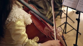Girl playing with cello stock video footage