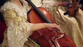 Girl playing with cello stock video