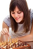 Girl playing chess Stock Photo