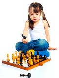 Girl playing chess Stock Photos