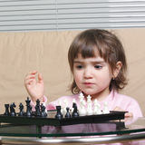Girl playing chess royalty free stock image
