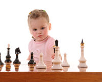 Girl playing the chess royalty free stock photo