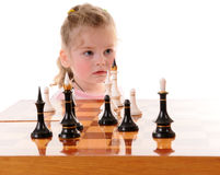 Girl playing the chess Royalty Free Stock Photography