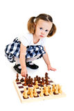 Girl playing chess Stock Image