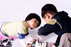 Girl playing chess. A picture of a little chinese girl playing chess alone Stock Photos