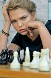 Girl playing chess. Stock Photo