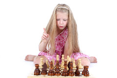 Girl playing chess on white Royalty Free Stock Photo