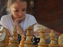Girl playing chess Stock Photo