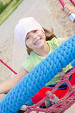 Girl playing on children's playground. Small girl playing on children's playground Stock Photography