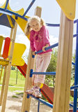 Girl playing on childrens staircase Royalty Free Stock Image