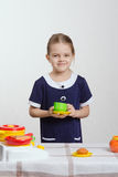 Girl playing in the children's ware Stock Photography