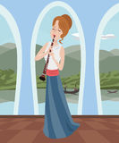 Girl playing clarinet at romantic hall Royalty Free Stock Image