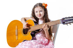 Girl playing classical guitar isolated on a white background Royalty Free Stock Photo