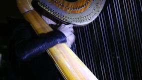 Girl playing classical music on a harp stock footage