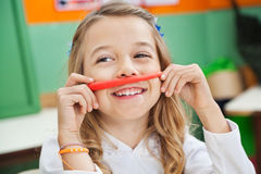 Girl Playing With Clay In Kindergarten Stock Photography