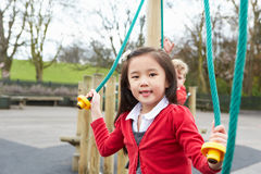 Girl Playing On Climbing Frame In School Playground Royalty Free Stock Photography