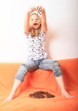 Girl playing with coffee grains Royalty Free Stock Photo