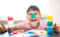 Girl playing with color play dough Royalty Free Stock Images