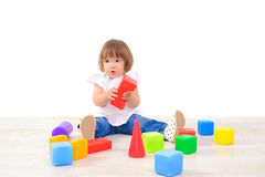 Girl playing with colored cubes Stock Images