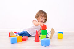 Girl playing with colored cubes Royalty Free Stock Photos
