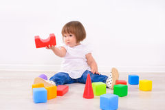 Girl playing with colored cubes Stock Photography