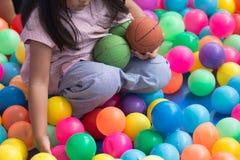 Girl playing. A girl playing colorful balls Stock Image