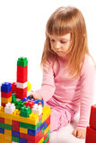 Girl  playing with colorful blocks. Little girl sitting at the floor and playing with colorful blocks Stock Photos