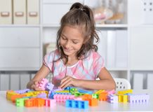 Girl playing with colorful plastic blocks Royalty Free Stock Photo