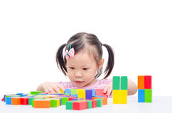 Girl playing colorful wood blocks Royalty Free Stock Photography