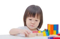 Girl playing colorful wood blocks Royalty Free Stock Image