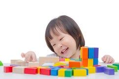 Girl playing colorful wood blocks Royalty Free Stock Photo