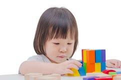 Girl playing colorful wood blocks Stock Photo