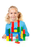 Girl is playing with colorful wooden blocks Royalty Free Stock Images