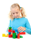 Girl is playing with colorful wooden blocks Stock Photography