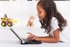 Girl playing computer Royalty Free Stock Photo