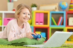 Girl is playing a computer game Stock Photos