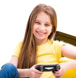 Girl playing computer game on playing console Stock Images