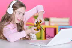 Girl playing a computer game Stock Photo