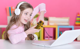 Girl playing a computer game Royalty Free Stock Image