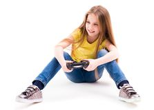 Girl playing computer games with a joypad. Cute teenage girl playing her computer games with a joypad, active and good gamer Stock Photos