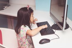 Girl playing with a computer royalty free stock photography