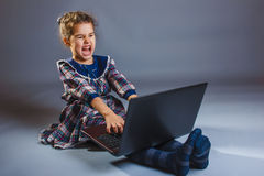 Girl playing on the computer very emotional Royalty Free Stock Image