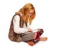 Girl playing computer. Young girl playing on the computer stock photos