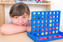 Girl playing Connect Four Stock Images