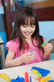 Girl Playing With Construction Blocks In Classroom Royalty Free Stock Photography