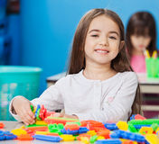 Girl Playing With Construction Blocks With Friends Stock Image