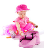 Girl  playing with cosmetics Royalty Free Stock Photos
