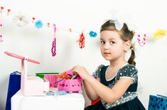 Girl playing with cosmetics and jewelry Stock Image