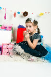 Girl playing with cosmetics and jewelry Stock Photo